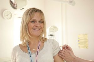marion-louki-head-of-midwifery-and-gynaecology-at-epsom-and-st-helier-hospitals-having-her-flu-jab