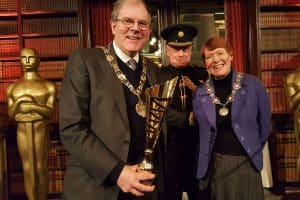 The Mayor of Sutton Cllr Richard Clifton receives the fourth place trophy from the Deputy Lieutenant of Greater London Roger Bramble DL, watched by the Mayoress Gloria Clifton.