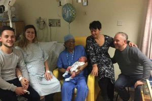 Georgia-Anthony-left-her-family-and-Dr-Madhab-Saha-centre-celebrate-the-arrival-of-Georgias-son-Ronnie.